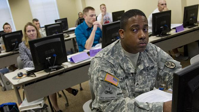 In this photo taken July 18, 2012, U.S. Army Sgt. Muhammed Lawson, a health care specialist, carefully listens to an instructor during a resume writing class at Joint Base Myers Henderson Hall in Arlington, Va. Lawson, who has served for nine years as an active duty Army soldier is planning to separate in April 2013. U.S. combat troops patrol dusty pathways in Afghanistan, look for hidden roadside bombs, load and fire mortar shells at insurgents' positions. So when they come home, how will that help them land a civilian job?  (AP Photo/Haraz N. Ghanbari)