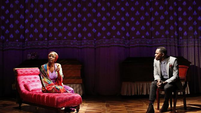 """This theater image released by The Public Theater shows Sharon Washington, left, and Colman Domingo in a scene from Domingo's new play """"Wild With Happy,"""" performing off-Broadway at The Public Theater in New York.  (AP Photo/Public Theater, Joan Marcus)"""