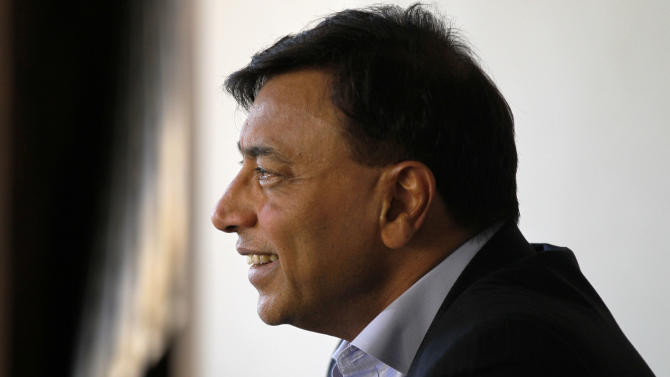 Chairman and CEO of ArcelorMittal, Lakshmi Mittal talks to the Associated Press in London about the ArcelorMittal Obit observation tower which stands next to the Olympic Stadium in the Olympic Park, Monday, July 23, 2012, in London. Opening ceremonies for the 2012 London Olympics will be held Friday, July 27. (AP Photo/Sang Tan)