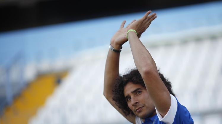Malaga's newly signed goalkeeper Guillermo Ochoa from Mexico waves to supporters during his official presentation at Rosaleda stadium, in Malaga