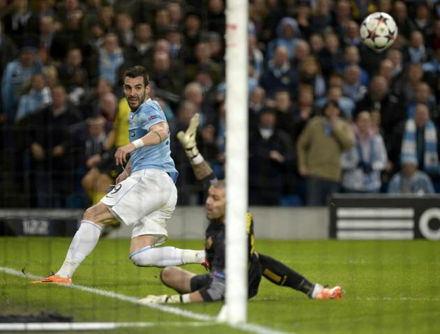 Manchester City's Alvaro Negredo shoots during their Champions League round of 16 first leg soccer match against Barcelona at the Etihad Stadium in Manchester