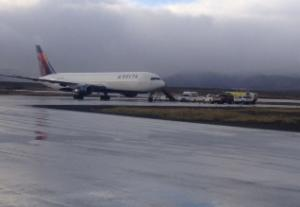 This Oct. 30, 2013, photo provided by the State of Alaska Central Region Department of Transportation & Public Facilities shows a Delta Airlines plane on a runway in Cold Bay, Alaska. A Delta Airlines flight made an emergency landing in a remote Alaska community near the Aleutian Islands Wednesday morning after a warning message flashed on an engine control panel. (AP Photo/State of Alaska Central Region Department, Jeff Doerning)