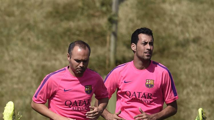 Barcelona soccer team train during pre-season at St. George's Park in central England
