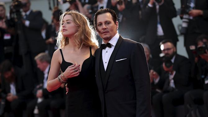 """Actor Depp and his wife Heard attend the red carpet event for the movie """"Black Mass"""" at the 72nd Venice Film Festival"""