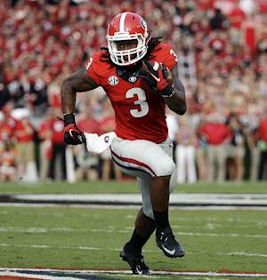 In this Aug. 30, 2014, file photo, Georgia's Todd Gurley runs the ball in the first half of an NCAA college football game against Clemson in Athens, Ga. Gurley has been suspended indefinitely while the school investigates an alleged violation of NCAA rules, the school announced Thursday, Oct. 9, 2014