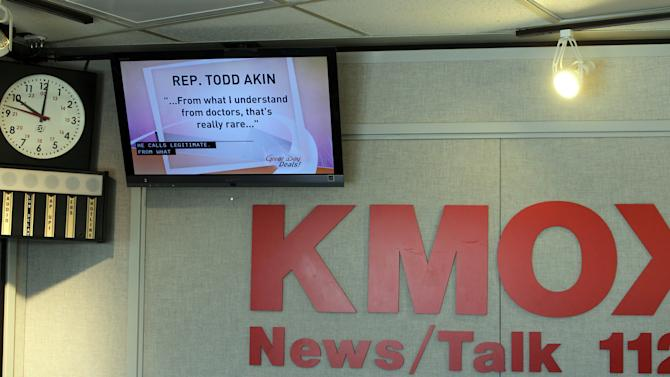 """FILE - In this Aug. 20, 2012 file photo, a televison monitor displays comments from Rep. Todd Akin's at studios of KMOX in St. Louis.  Akin was scheduled to be on the Charlie Brennan show, but didn't come in or call the station.  Until this week, Rep. Todd Akin was virtually unknown beyond his district, associated more with his deep religious convictions than any legislative achievements. Long before his comments about women's bodies and """"legitimate rape"""" made him a flashpoint in the fall campaign, this congressional backbencher was a favorite among home-schooling organizations and conservative church groups. (AP Photo/St. Louis Post-Dispatch, J.B. Forbes) EDWARDSVILLE INTELLIGENCER OUT; THE ALTON TELEGRAPH OUT"""