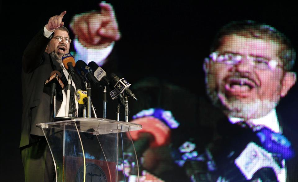 FILE - In this Sunday, May 20, 2012 file photo, the Muslim Brotherhood's presidential candidate Mohammed Morsi speaks at his last rally in Cairo, Egypt. Egypt's electoral commission announced Sunday, June 24, 2012 that Morsi is victor of landmark presidential vote. (AP Photo/Fredrik Persson, File)