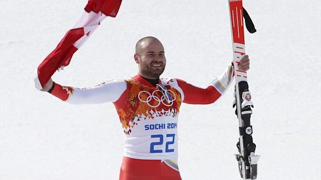 Canada's third-placed Jan Hudec celebrates his bronze