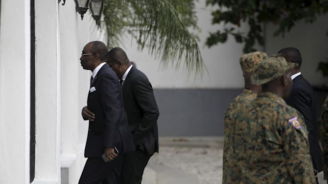 Haitian Prime Minister Evans Paul arrives for the inauguration of the provisional Haitian president Jocelerme Privert in the gardens of the National Palace in Port-au-Prince