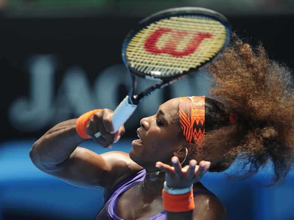 Serena Williams of the US hits a forehand return to Spain's Garbine Muguruza during their second round match at the Australian Open tennis championship in Melbourne, Australia, Thursday, Jan. 17, 2013. (AP Photo/Andrew Brownbill)