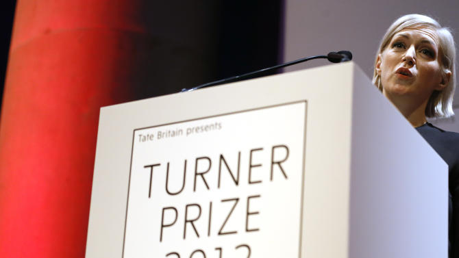 Elizabeth Price, the winner of the Turner Prize 2012 delivers a speech at the Tate Britain art gallery in London, Monday, Dec. 3, 2012. (AP Photo/Kirsty Wigglesworth)