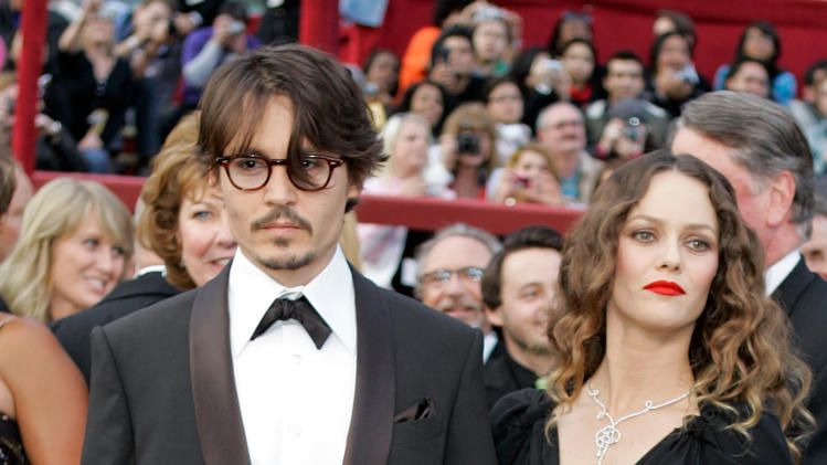 "FILE - This Feb. 24, 2009 file photo shows Johnny Depp, nominated for an Oscar for best actor in a leading role for his work in ""Sweeney Todd The Demon Barber of Fleet Street,"" arriving with his girlfriend Vanessa Paradis for the 80th Academy Awards in Los Angeles. Depp and his longtime partner, Vanessa Paradis, have split. A publicist for Depp said in a statement Tuesday, June that the couple ""amicably separated."" The statement requested privacy for the former couple and their two children, 9-year-old Jack and 13-year-old Lily-Rose. Depp and Paradis never married during their 14-year relationship. The American actor met the French model-singer in 1998. (AP Photo/Amy Sancetta, file)"