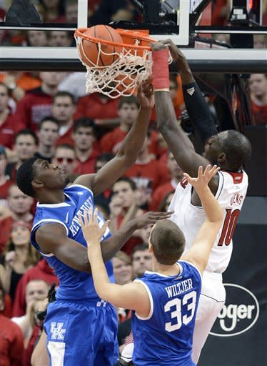 No. 4 Louisville holds off Kentucky, 80-77
