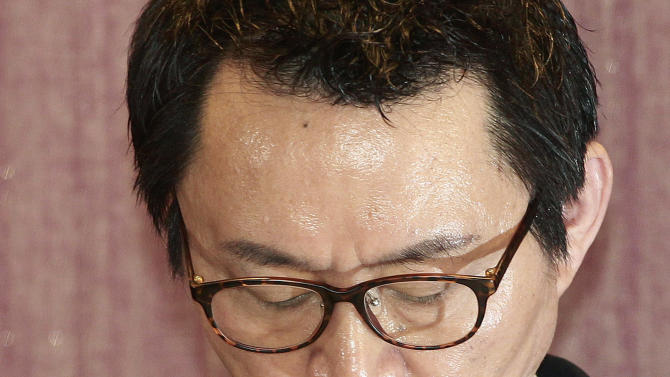 "South Korean President Park Geun-hye's spokesman Yoon Chang-jung looks down during a press conference in Seoul, South Korea, Saturday, May 11, 2013. Park fired Yoon because of what her office said Friday was a ""disgraceful incident"" during Park's trip to the United States, in what could be a domestic blow after an otherwise widely praised appearance in Washington. Without elaborating, the presidential Blue House said on its website that unspecified actions by Yoon marred the government's dignity. (AP Photo/Ahn Young-joon)"