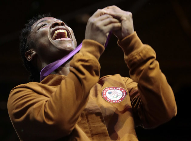 Gold medalist Claressa Shields of the United participates in the medals ceremony after their women's final middleweight 75-kg gold medal boxing match at the 2012 Summer Olympics, Thursday, Aug. 9, 201