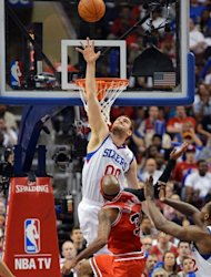 Spencer Hawes of the Philadelphia 76ers jumps to block a shot by Chicago Bulls&#39; Richard Hamilton during game three of the Eastern Conference first-round NBA playoff series on May 4. The 76ers rallied to beat the Bulls 79-74 and gain a 2-1 lead
