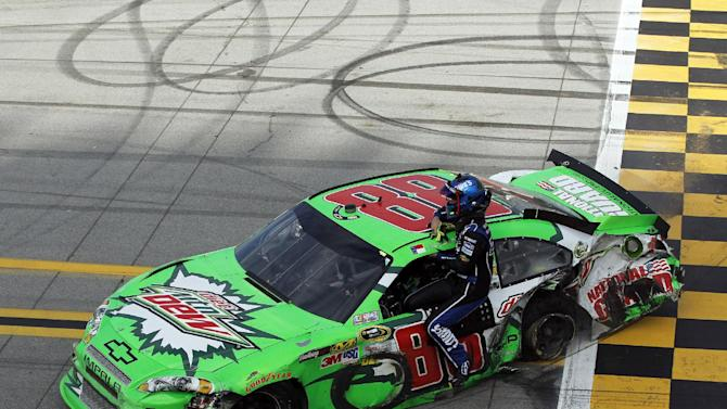 Dale Earnhardt Jr., (88) gives Jimmie Johnson a ride back to the pits after the NASCAR Sprint Cup Series auto race at Talladega Superspeedway in Talladega, Ala., Sunday, Oct. 7, 2012. (AP Photo/Tom Pennington, Pool)