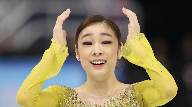 Yuna Kim of South Korea reacts after completing her routine in the women's short program figure skating competition at the Iceberg Skating Palace during the 2014 Winter Olympics, Wednesday, Feb. 19, 2014, in Sochi, Russia