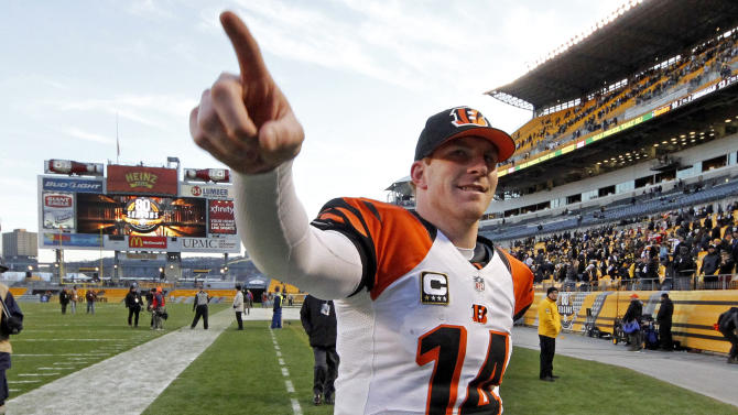 Cincinnati Bengals quarterback Andy Dalton acknowledges Bengals fans as he walks of the field after the Bengals' 13-10 win over the Pittsburgh Steelers in an NFL football game in Pittsburgh, Sunday, Dec. 23, 2012. (AP Photo/Gene J. Puskar)