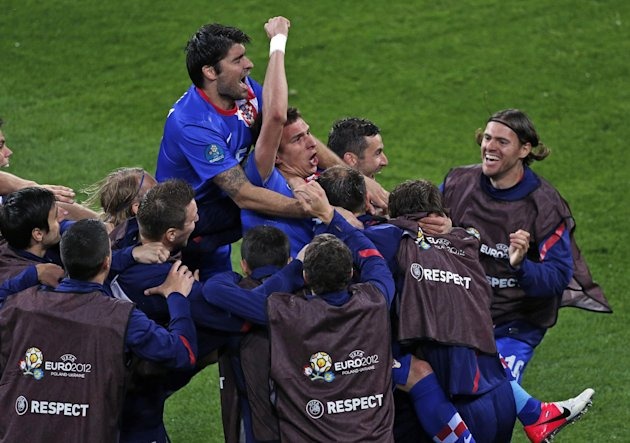Croatia's Mario Mandzukic, center, celebrates after he scored his team's third goal during the Euro 2012 soccer championship Group C match between the Republic of Ireland and Croatia in Poznan, Poland