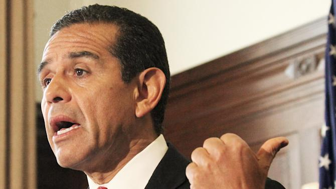 """FILE - In this Nov. 30, 2011 file photo, Los Angeles Mayor Antonio Villaraigosa speaks at the Los Angeles City Hall. Villaraigosa says Republican efforts to use Latino speakers at the GOP national convention to win over Latino voters won't work. Antonio Villaraigosa told reporters Tuesday that the GOP """"can't just trot out a brown face or a Spanish surname"""" and expect Latinos to vote Republican. He called that window dressing.  (AP Photo/Reed Saxon, File)"""