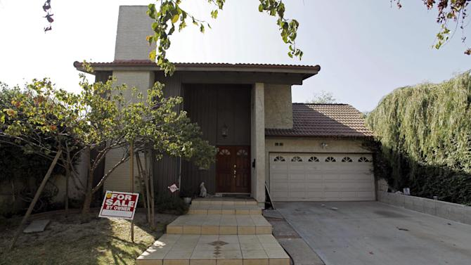 """This Tuesday, Sept. 25, 2012, photo shows a """"For Sale"""" sign at the home of Nakoula Basseley Nakoula, the man who made the film """"Innocence of Muslims"""" that has sparked violent protests, on a street in Cerritos, Calif. The filmmaker has received death threats and was forced into hiding after the 14-minute movie trailer rose to prominence. (AP Photo/Reed Saxon)"""