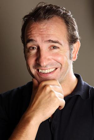 """In this Sept. 12, 2011 photo, actor Jean Dujardin poses for a portrait to promote the film """"The Artist,"""" during the 36th Toronto International Film Festival in Toronto, Canada. The film is a black-and-white silent movie about a 1920s Hollywood star whose career crumbles as talkies take over the big screen.  (AP Photo/Carlo Allegri)"""
