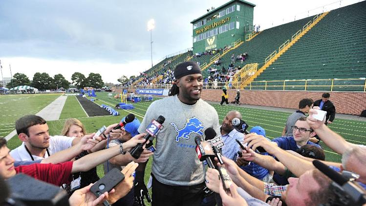 Lions running back  Joique Bell addresses the media before the rest of the team arrives for NFL football training camp at Wayne State University in Detroit , Wednesday, July 30, 2014
