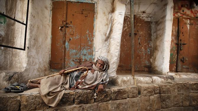 Homeless man rests on the side of a street at the old quarter of Yemen's capital Sanaa