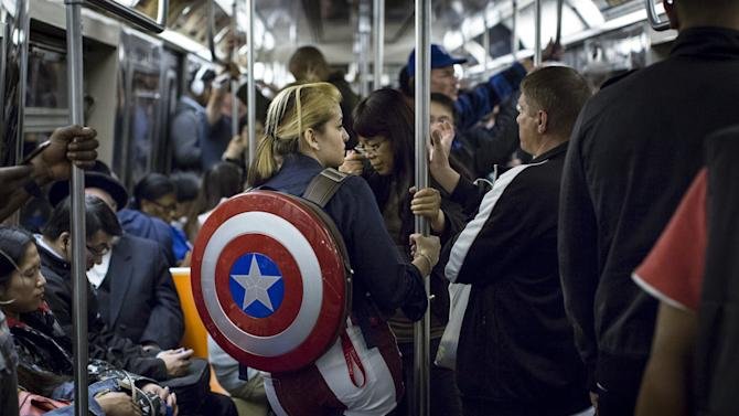 A woman in costume rides the subway at the conclusion of the first day of New York Comic Con in Manhattan