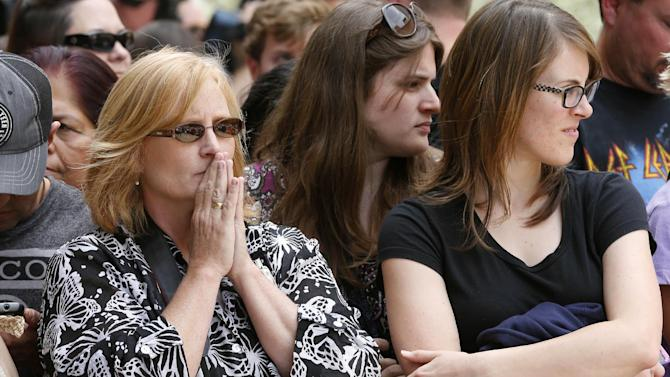 Spectators wait for a verdict in the murder trial of Jodi Arias, Wednesday, May 8, 2013 in Phoenix. Arias was convicted of first-degree murder Wednesday in the 2009 killing of her one-time boyfriend Travis Alexander after a four-month trial.  (AP Photo/Matt York)