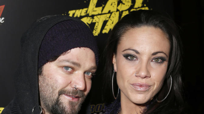 """Bam Margera and Nicole Boyd attend the LA premiere of """"The Last Stand"""" at Grauman's Chinese Theatre on Monday, Jan. 14, 2013, in Los Angeles. (Photo by Todd Williamson/Invision/AP)"""
