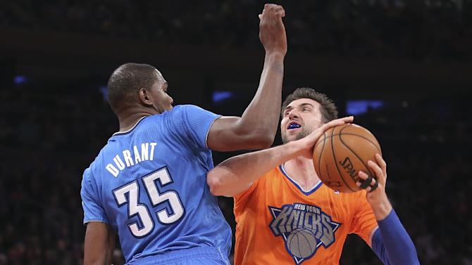 New York Knicks power forward Andrea Bargnani (77) shoots against Oklahoma City Thunder forward Kevin Durant (35) during the first half of their NBA basketball game at Madison Square Garden, Wednesday, Dec. 25, 2013, in New York. (AP Photo/John Minchillo)
