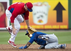 Toronto Blue Jays shortstop Emilio Bonifacio, right, steals second base as Philadelphia Phillies second baseman Chase Utley, left, was late on the tag during second inning MLB Grapefruit League baseball action in Clearwater, Fla., on Sunday, March 3, 2013. THE CANADIAN PRESS/Nathan Denette