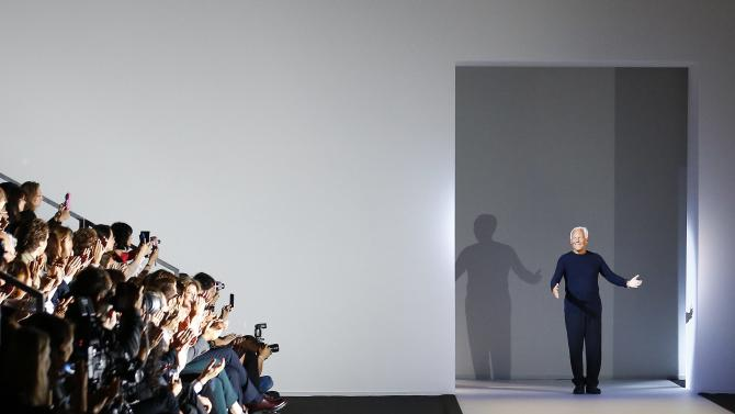 Armani acknowledges the applause at the end of his Spring/Summer 2015 collection during Milan Fashion week