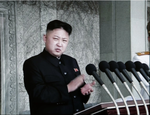In this image made from KRT video, North Korean leader Kim Jong Un claps before giving his first public speech during a massive celebration marking the 100th birthday of national founder Kim Il Sung, 