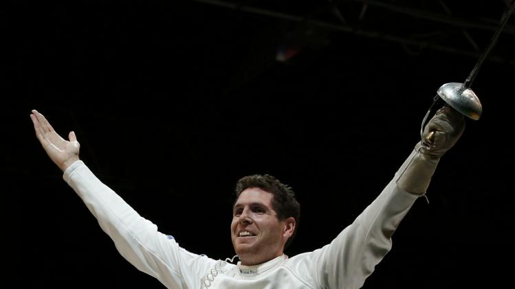 Grumier of France celebrates victory over Jung of South Korea in the men's team epee final match at the World Fencing Championships in Kazan