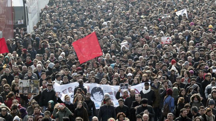 Mourners march as they follow the coffin of Berkin Elvan during funeral ceremony in Istanbul