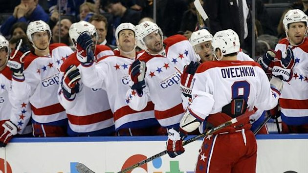 Teammates congratulate Washington Capitals left wing Alex Ovechkin (8) after he scored (Reuters)