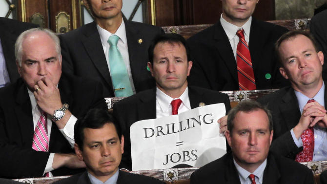 Rep. Jeff Landry, R-La., holds a sign during a speech by President Barack Obama to a joint session of Congress at the Capitol in Washington, Thursday, Sept. 8, 2011.  (AP Photo/J. Scott Applewhite)