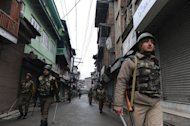 Indian paramilitary soldiers are seen patrolling on a deserted street in Srinagar, on February 15, 2013. Indian troops have shot dead a Pakistani soldier along the de facto border in the disputed Kashmir region in the first deadly exchange since a truce was agreed a month ago