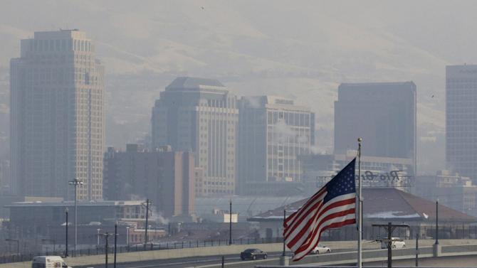 This Jan. 4, 2013, file photo, shows the haze from an inversion hanging over downtown Salt Lake City. The geography that makes Utah one of the world's most beautiful places also brings the nation's dirtiest air in winter, when an icy fog smothers mountain valleys for days or weeks at a time. A group of doctors is declaring a health emergency over northern Utah's lingering pollution problem. Utah Physicians for a Healthy Environment planned to deliver a petition Wednesday demanding immediate action by elected officials. The group wants Gov. Gary Herbert and mayors of northern Utah cities to cut the pollution. (AP Photo/Rick Bowmer)