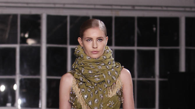 The Altuzarra Spring 2013 collection is modeled during Fashion Week, Saturday, Sept. 8, 2012, in New York. (AP Photo/Jason DeCrow)