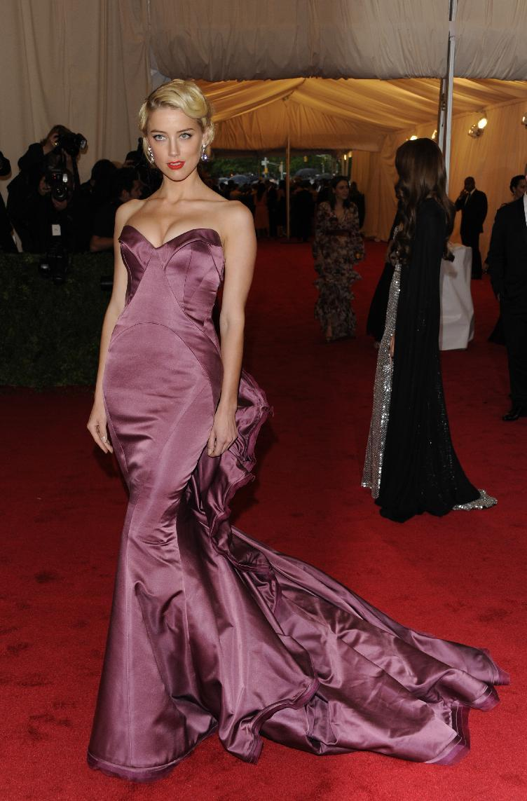 Amber Heard arrives at the Metropolitan Museum of Art Costume Institute gala benefit, celebrating Elsa Schiaparelli and Miuccia Prada, Monday, May 7, 2012 in New York. (AP Photo/Evan Agostini)