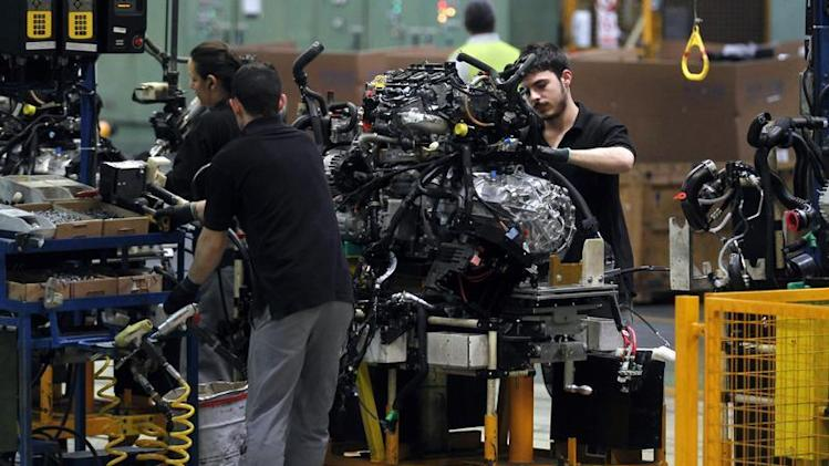 Nissan Motor staff work on engines at the Zona Franca Nissan factory near Barcelona