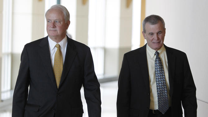 District Attorney Scott Story, right, and assistant Pete Weir leave district court after a hearing in the case against  Austin Reed Sigg, 17, in Golden, Colo. on Tuesday, Oct. 30, 2012. Sigg is the suspect arrested in connection with the death of 10-year-old Jessica Ridgeway who disappeared Oct. 5 after leaving home for school. Her remains were found 5 days later. It was announced in court that Sigg would be tried as an adult in connection with her death. (AP Photo/Ed Andrieski)