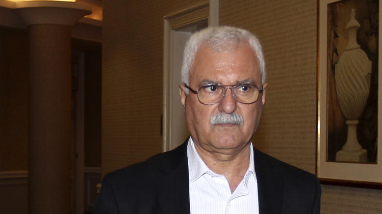 Syrian regime opponent George Sabra arrives at the Election of the Executive Office of the Syrian National Council in Doha, Qatar, Friday, Nov. 9, 2012. (AP Photo/Osama Faisal)