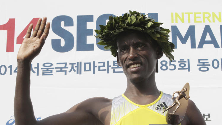 Yacob Jarso Kintra of Ethiopia waves during the award ceremony after winning the men's race of the Seoul International Marathon at Olympic stadium in Seoul, South Korea, Sunday, March 16, 2014. Kintra finished with a time of two hours, six minutes and 17 seconds. (AP Photo/Ahn Young-joon)