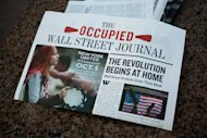 """Members of the Occupy Wall Street media organization produced  bails of newspapers chronicling the past three weeks of protests under  the title """"The Occupied Wall Street Journal,"""" Sunday, Oct. 2,  2011, in New York. Over 700 protestors were arrested on Saturday when  they marched on the Brooklyn bridge while protesting against corporate  greed and police brutality. (AP Photo/John Minchillo)"""