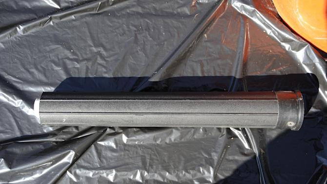 This undated photo provided by the FBI shows a silencer found in a bucket discovered at a Parishville, N.Y. reservoir after a man jailed in Alaska admitted to a series of killings, including an Anchorage barista and a couple from Vermont. (AP Photo/FBI)